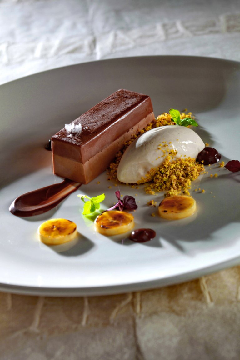 Milk chocolate mousse with chocolate jelly, pistachio crumble and banana ice-cream
