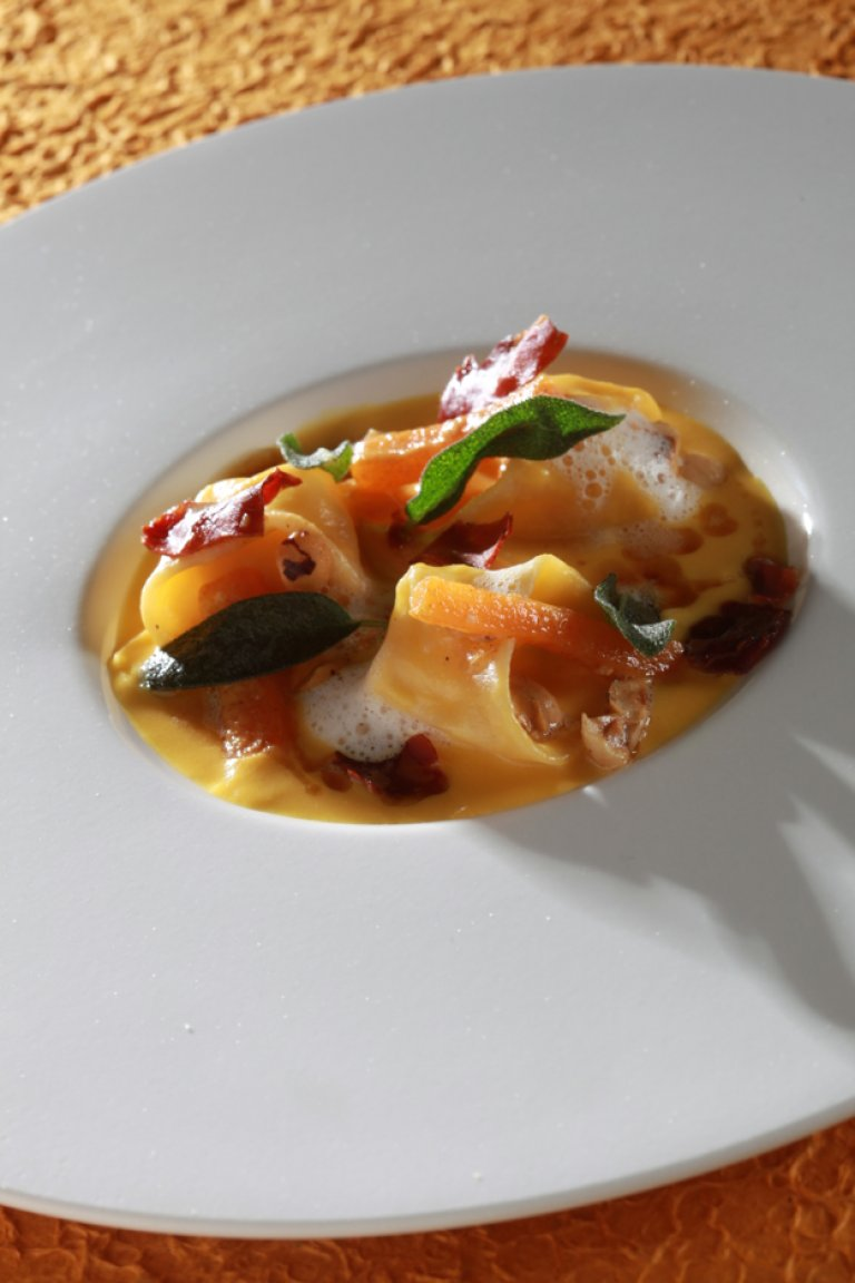 Tortellini filled with goat's cheese, pumpkin cream and brown butter