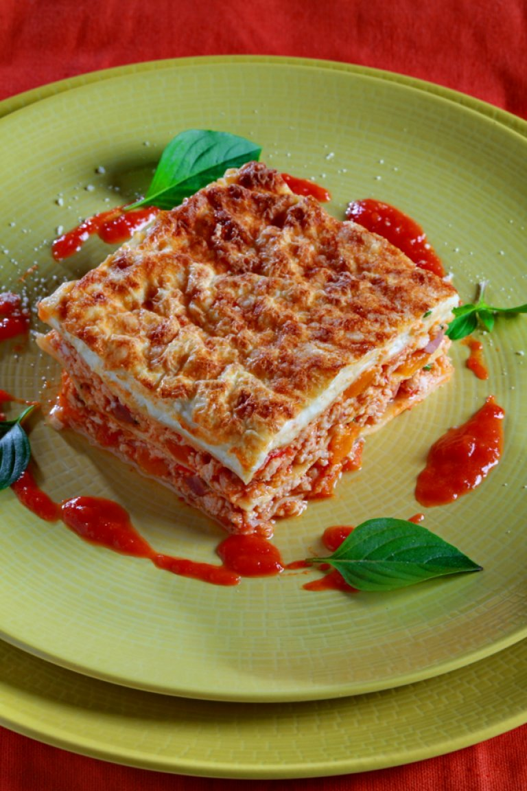Lasagna with ground beef, vegetables and prosciutto