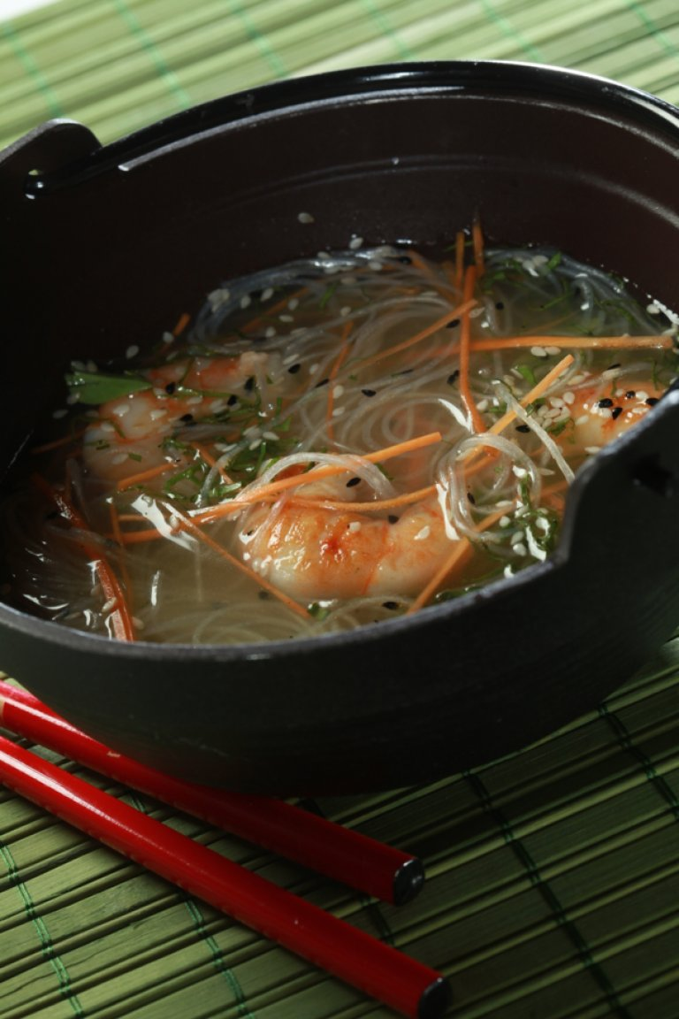 Carrot consommé with lemongrass, ginger, spicy Asian grilled shrimp, and bean threads