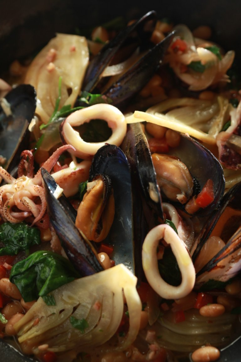 Sauteed squid and steamed mussels with beans, spinach, and pancetta