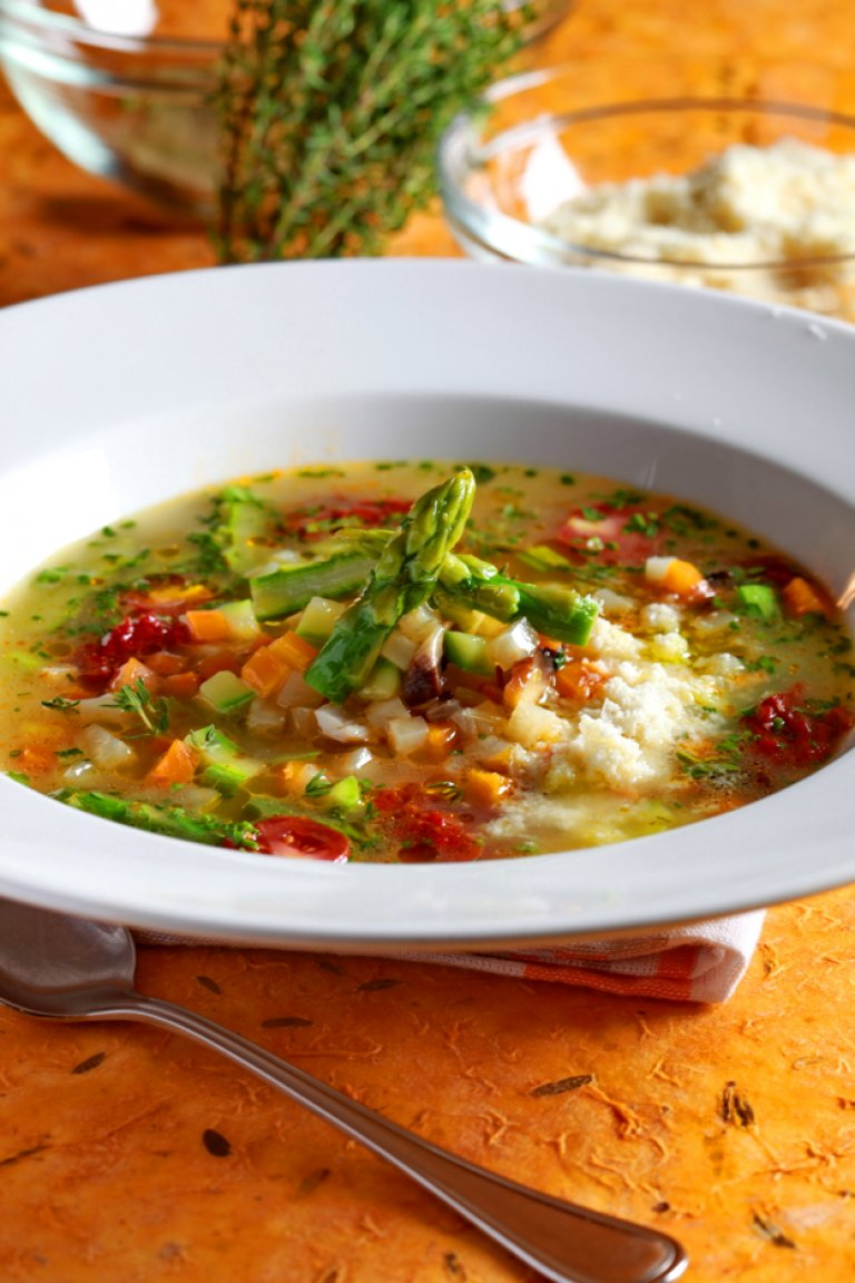 Chicken soup with vegetables and Parmesan