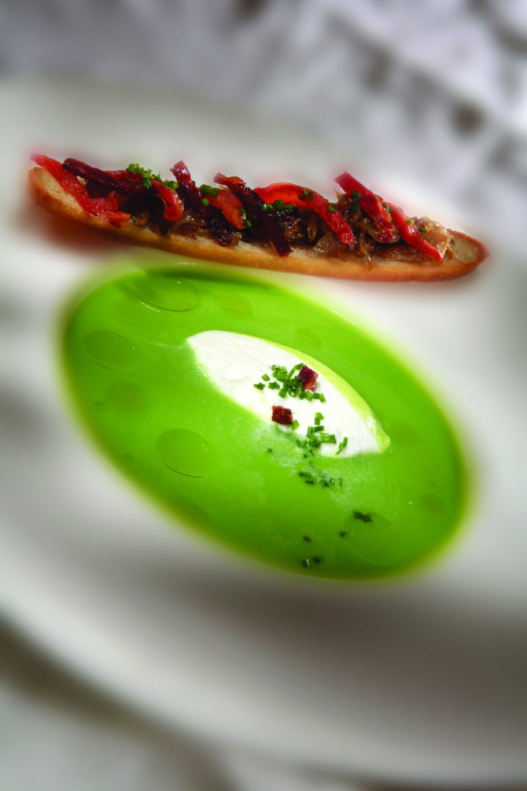 Pea soup with mushroom bruschetta, roast tomato and chorizo sausage